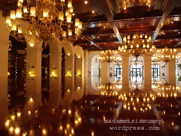 Chandeliers and their reflection on the grand piano